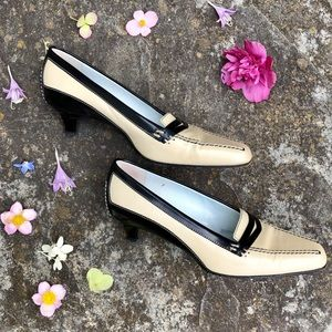 Beige and black Tod's loafer pumps